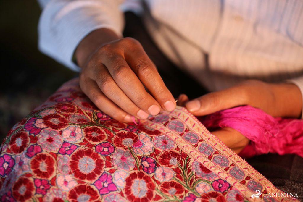 Pashmina Artisan doing Embroidery work on a Pashmina Shawl